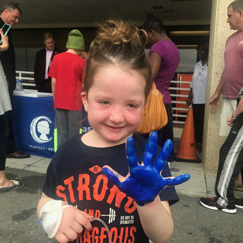 Young Girl Participates in a Hyundai Hope on Wheels Handprint Ceremony at Arkansas Children's in Little Rock on August 15th