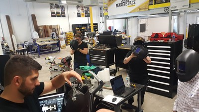 Stanley Black & Decker's Makerspace allows employees the opportunity to bring ideas to life. Here, employees practice welding in the new space.