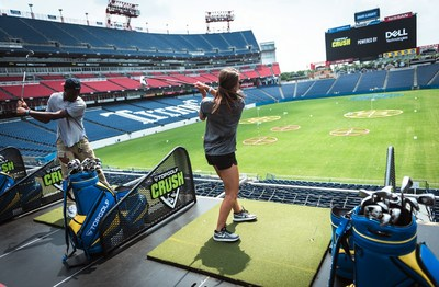 Guests tee off at Topgolf Crush in Nashville at Nissan Stadium