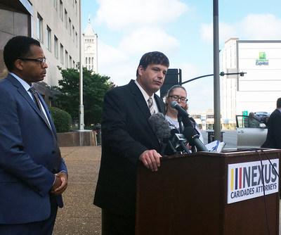 Mario Williams, Nexus Caridades Attorneys, Inc. Civil Rights Chief; Mike Donovan, Civil Rights Advocate and CEO of Nexus Services, Inc. (at Podium); Christel Ward, Victim and Plaintiff