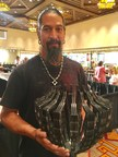 "Pat Pruitt (Laguna Pueblo), 2017 Best of Show winner at Santa Fe Indian Market, with his winning piece. ""Sentinel v1.0"" was entered into the sculpture classification; it is made of zirconium and titanium. The 96th Santa Fe Indian Market, presented by the Southwestern Association for Indian Arts (SWAIA) is held on August 19 and 20."