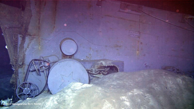 An image shot from a remotely operated vehicle shows wreckage which appears to be one of the two anchor windlass mechanisms from the forecastle of the ship.  Note the star-emblazoned capstans in this photo dated July 12, 1945 just weeks before the ship was lost. Photo courtesy of Paul G. Allen