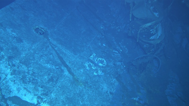 "An image shot from a remotely operated vehicle shows what appears to be the painted hull number ""35."" Based on the curvature of the hull section, this seems to be the port side of the ship. Photo courtesy of Paul G. Allen"
