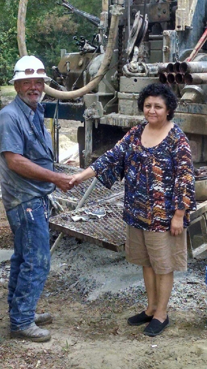 Drillers from Bishop's Well Drilling congratulates Ruth Doss on her new well in Colquitt County, GA.