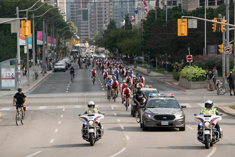 The more than 100 participants of the Highway of Heroes ride cycle up University Ave. towards the finish line at Queen's Park. (CNW Group/Wounded Warriors Canada)