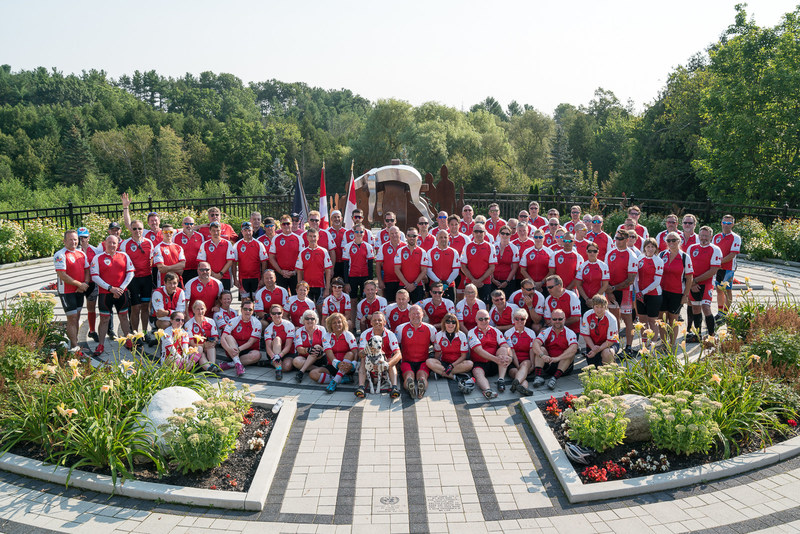 The participants of the Highway of Heroes Ride pose in Park of Reflection in Whitby during the start of the of Sunday's ride. (CNW Group/Wounded Warriors Canada)