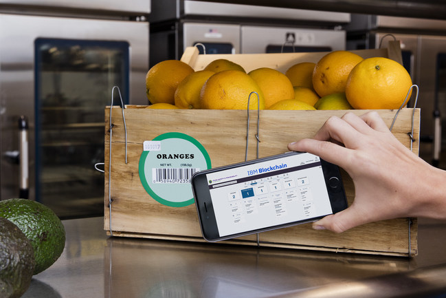 IBM Announces Blockchain Collaboration with Major Retailers and Food Companies to Address Food Safety - A group of the world's leading retailers and food companies are working with IBM to explore how blockchain technology can be used to make the food supply chain safer. Blockchain technology can be used to improve food traceability by providing trusted information on the origin and state of food. Pictured is a crate of oranges being scanned as part of a food safety blockchain. (Photo credit: Connie Zhou for IBM)