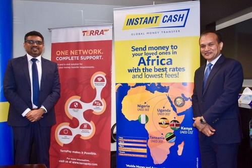 L to R - Philip C Daniel, Acting CEO Instant Cash and Ambar Sur Founder & CEO TerraPay (PRNewsfoto/TerraPay)