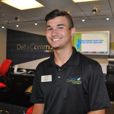 Collins Hill High School student Jeffrey Clark works at the Delta Community Credit Union branch in Suwannee, Ga.