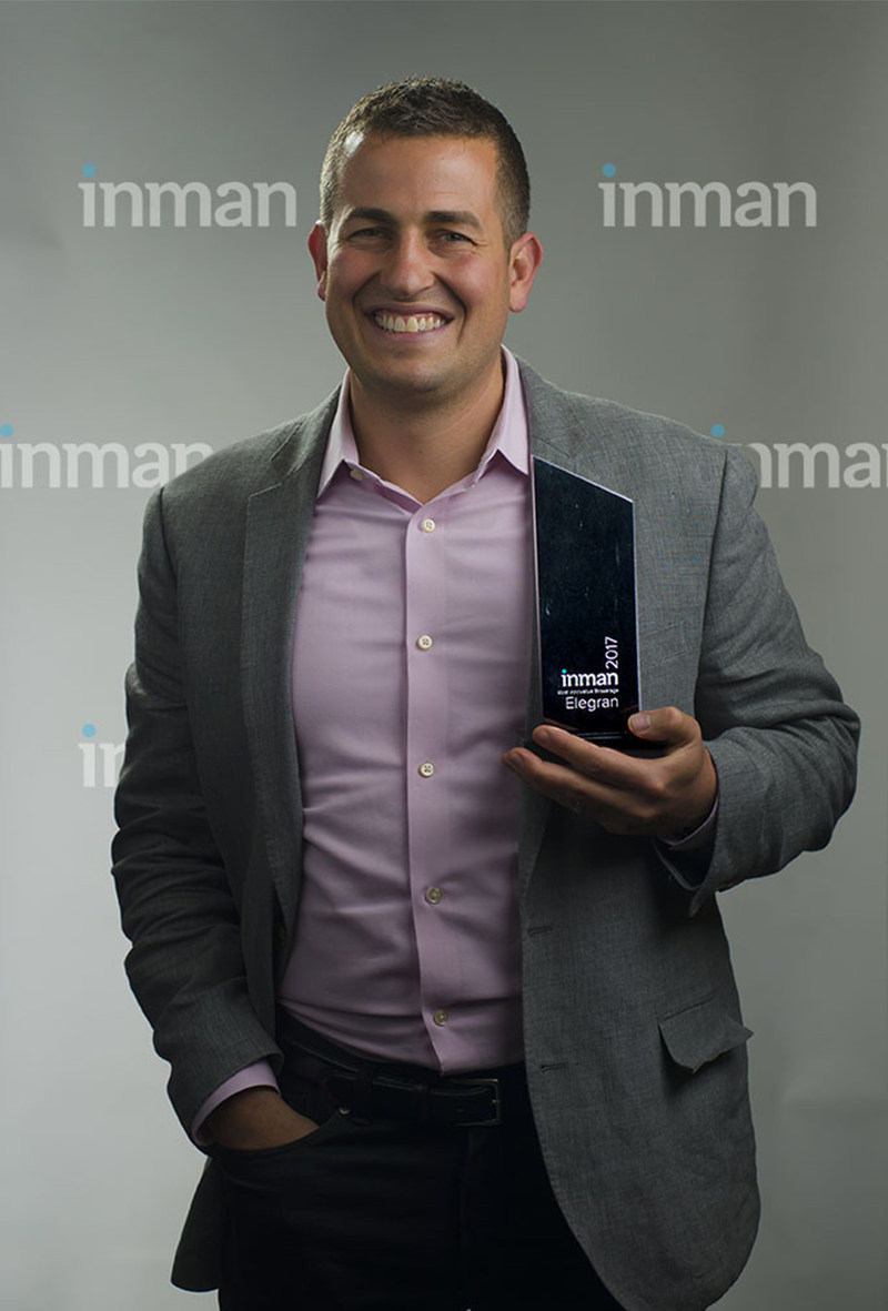 """Michael Rossi, CEO of Elegran Real Estate, accepts award for """"Most Innovative Brokerage"""" in America"""
