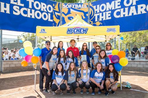 Morinaga America, Inc. C.E.O. Masao Hoshino celebrates the renovation of El Toro High School's softball field alongside the softball team and coaching staff.