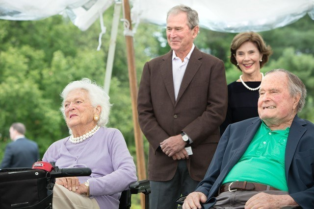 The Bush family looks on as 43 House is dedicated in honor of President George W. Bush.
