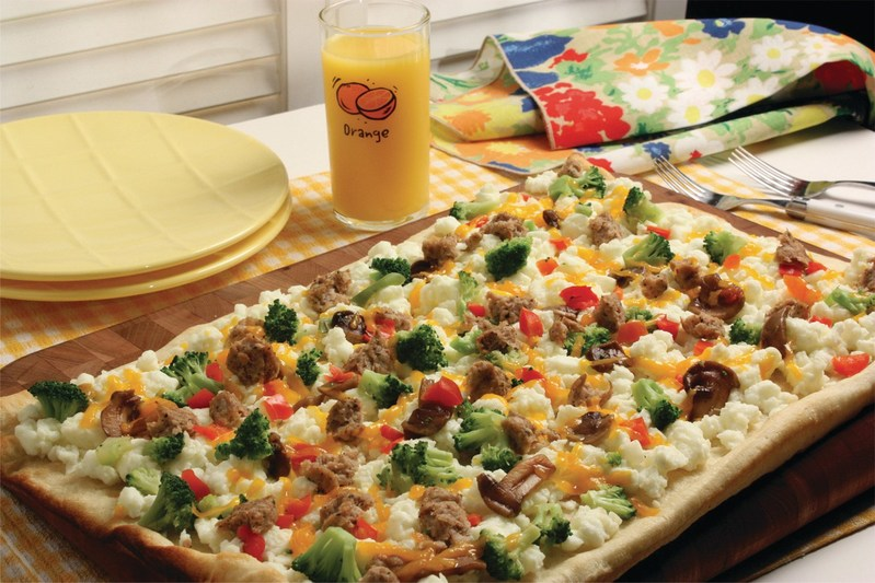 You can find this delicious Breakfast Sunrise Pizza recipe (and more) at EasyHomeMeals.com – easy to make anytime with convenient frozen and refrigerated ingredients stocked in your frig and at your fingertips. Guaranteed to be a family favorite!