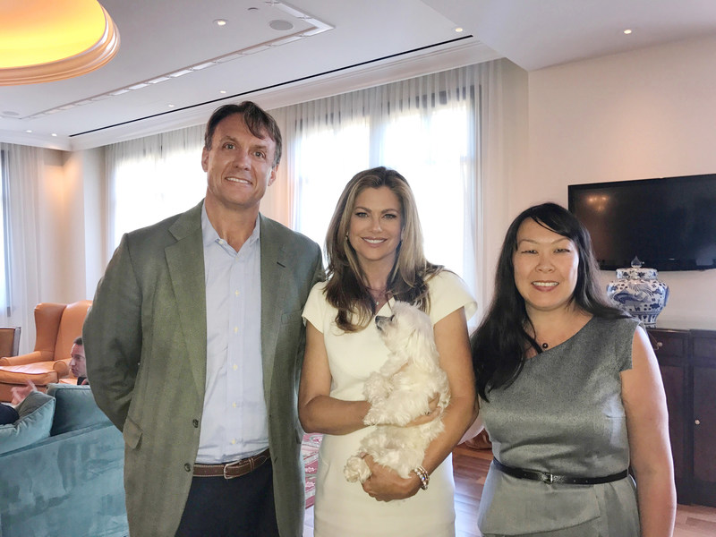 From left to right: Gardiner Smith, Kathy Ireland®, (Gracie, in Kathy's arms) and Chia Chia Sun.