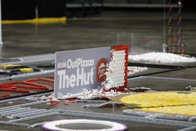 Pizza Hut is giving Hut Rewards members a shot at free pizza for life by guessing the number of dominoes toppled in its world record setting event that took place on Wednesday, Aug. 23, 2017, in Dallas. The dominoes feat took more than two days to build with 14 master builders, and highlighted Hut Rewards program perks, such as two points earned for every $1 spent online. Follow Pizza Hut on Facebook and YouTube for complete details. (AP Images for Pizza Hut)