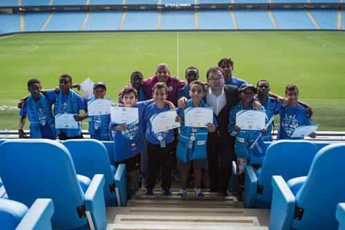 Gavin Rhodes, Head of City Football Schools (left) and Stephen Ha, General Manager, TECNO Mobile (right) launch the Blue Squad initiative at the Etihad Stadium (PRNewsfoto/TECNO Mobile)