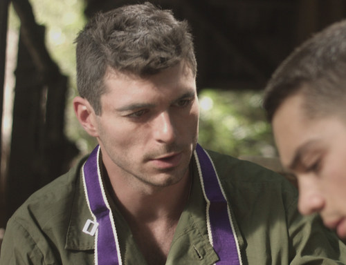"""In this scene from EWTN original docudrama """"Called and Chosen – Father Vincent R. Capodanno,"""" the Military Chaplain, played by Actor James Hutson, hears the battlefield confession of a fellow Marine, played by Michael Sedler. Premieres 10 p.m. ET, Wednesday, Aug. 30 on EWTN, http://www.ewtn.com/channelfinder. Encores at 3 p.m. ET, Saturday, Sept. 2; and 3 p.m. ET, Monday, Sept. 4."""