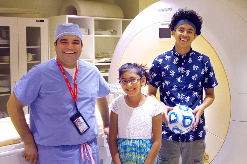 Karun Sharma, M.D., Ph.D., director of Interventional Radiology at Children's National Health System, poses with 10-year-old Niyati Shah and 16-year-old Alfredo Coreas, the first two children with osteoid osteoma successfully treated in the U.S. as part of an innovative research study using noninvasive MR-HIFU.