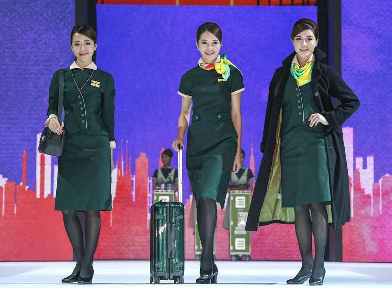 EVA Air revealed new uniforms for service staff on flights and at airports. Those for cabin crew and female ground staff have standing collars that suggest the idea of flying.
