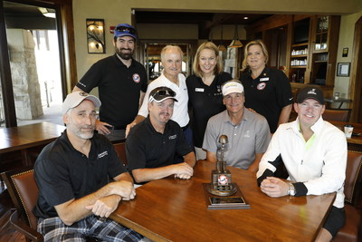 The TAPS team of Gabriel Rao, Founder and President Bonnie Carroll, and Marie Campbell, joined by Aimco Chief Administrative Officer Miles Cortez, presented the Ultimate Sacrifice Award to Karndean Design Flooring for its ongoing support of TAPS.  John Jarvis, Larry Browder, Milton Goodwin and Jon Troshynski accepted the honor on behalf of tournament Platinum Donor Karndean.