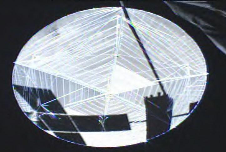 Satellite Selfie: EchoStar XXI casts its shadow on its 18 meter antenna from Harris. Image credit: SSL.