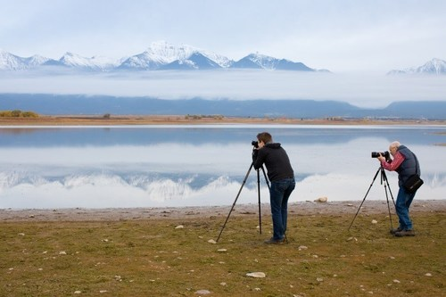 Neil Chaput and son, Forest, of Rocky Mountain School of Photography, snap a photo of the Montana scenery.