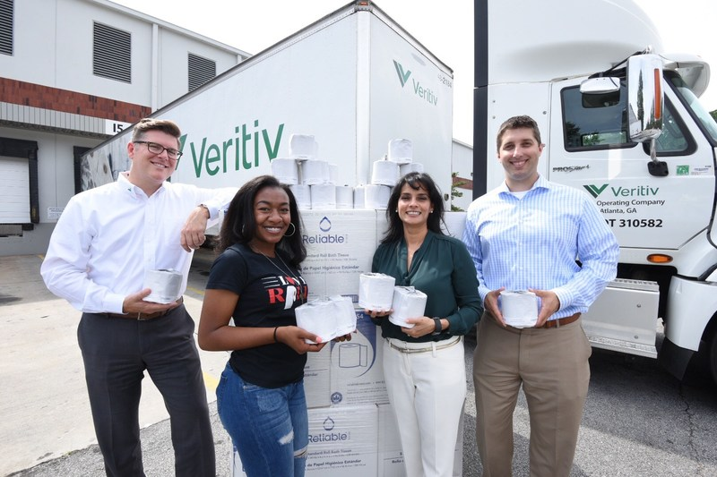Love Rolls, Inc., takes donation of 25,000 rolls of toilet paper from Veritiv to assist the homeless community in Atlanta and across the U.S.  Pictured from left: Robert Moore with Veritiv, Kendall Robinson of Love Rolls, Inc., Martha Issa of Veritiv, and Colin Bradley of Veritiv.