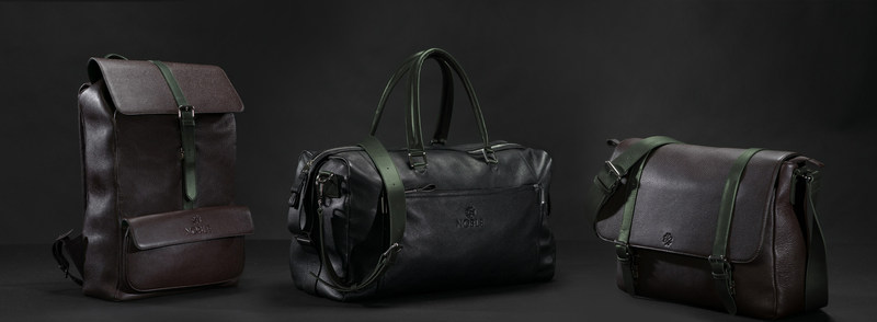 Noblemen is showing three different bags that are crafted from soft leather with a defining army green trim: The Explorer, The Weekender, and The Messenger.