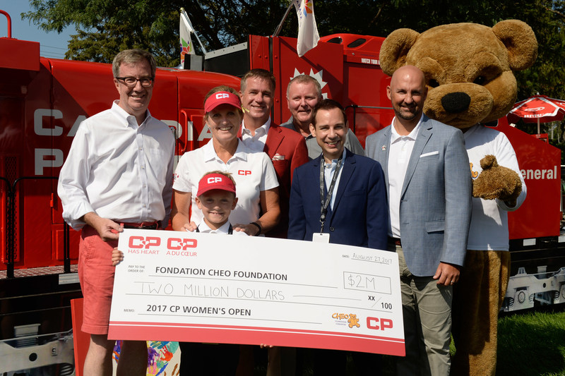 Jim Watson (Mayor of Ottawa), Lorie Kane (CP ambassador and Canadian Golf Hall of Famer), Zander Zatylny (CPWO child ambassador), Keith Creel (CP President and CEO), Kevin Keohane (President and CEO of CHEO Foundation), Alex Munter (President and CEO of CHEO Hospital), Laurence Applebaum (CEO of Golf Canada) gather for the $2 million cheque presentation, one of the largest charitable donations on the LPGA tour. (CNW Group/Canadian Pacific)