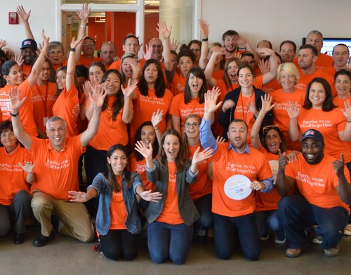 The Greater Boston Food Bank employees wear orange in support of Hunger Action Month. The public is encouraged to participate by wearing orange and getting involved in the various activities throughout the month of September.