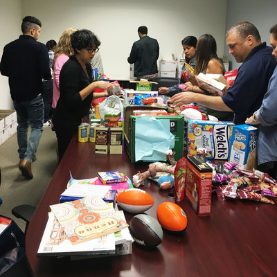 """Carrington Mortgage Services Associates making care packages to send to active U.S. servicemembers deployed around the world as part of The Carrington Charitable Foundation's """"Boxes for Our Troops Challenge."""""""