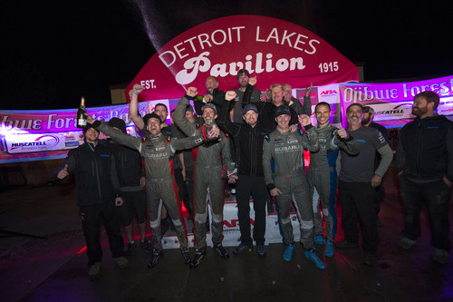 Travis Pastrana and co-driver Robbie Durant celebrate with their team