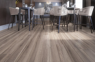 CorkWood Designer is so versatile, it can be used in residential and commercial spaces.  It adds warmth and character to this restaurant space while also providing the durability of an AC4 rated laminate (CNW Group/TORLYS Inc.)