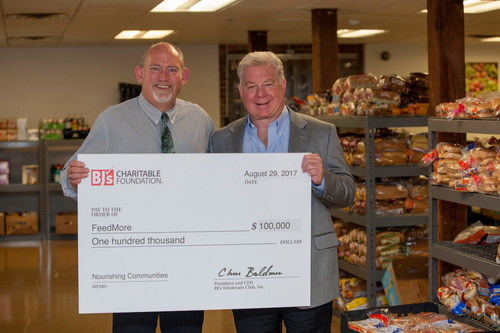 David Hicks, General Manager of BJ's Wholesale Club in Richmond, VA (left), presents a $100,000 grant from the BJ's Charitable Foundation to Douglas Pick, Chief Executive Officer of FeedMore (right) on August 29, 2017.