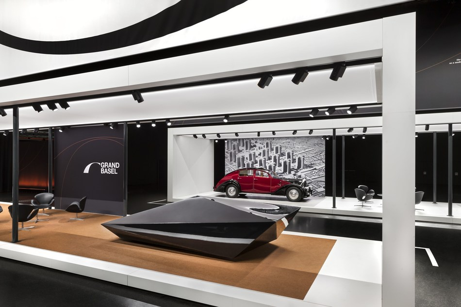 Automobile avant-garde from the past, present and future, representing the exhibition concept of Grand Basel. In front: Rem D. Koolhaas for United Nude - Lo Res Car (2017): The polygonal design of a Lamborghini Countach abstracted to the minimal wedge shape. Back: Avions Voisin, C25 Aérodyne (1935) - an icon of automotive technology and urbanity and the favorite brand of the Swiss architect LeCorbusier. Photo credit: Grand Basel / diephotodesigner.de (PRNewsfoto/Grand Basel)