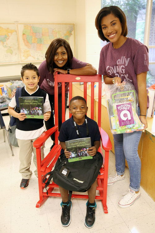 """Employees from Ally Financial distribute backpacks filled with school supplies and copies of Ally's financial literacy book """"Planet Zeee and the Money Tree"""" to students at Allenbrook Elementary is Charlotte, N.C. on Aug. 29, 2017. Ally joined with Classroom Central to distribute the backpacks and supplies to more than 1,000 students in Charlotte."""