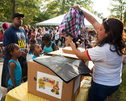 """Approximately 550 children and their families participated in a """"Back to School"""" event hosted by Henry Schein, Inc. at its worldwide headquarters in Melville, N.Y. where, in addition to new clothes and school supplies, they also enjoyed dinner, games, music, crafts, dress-up stations, and other fun activities."""