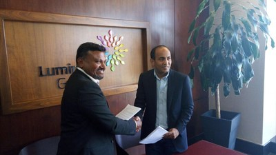 Campus Management International Managing Director Raj Mruthyunjayappa celebrates new partnership with Ibrahim Safadi, CEO of Luminus Group.