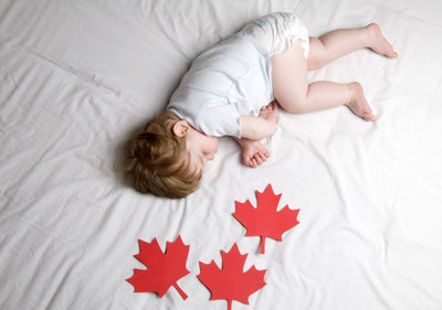 Canadian Baby, a young baby sleeping with Maple Leaves scattered around him. (CNW Group/Douglas by NOVOSBED)