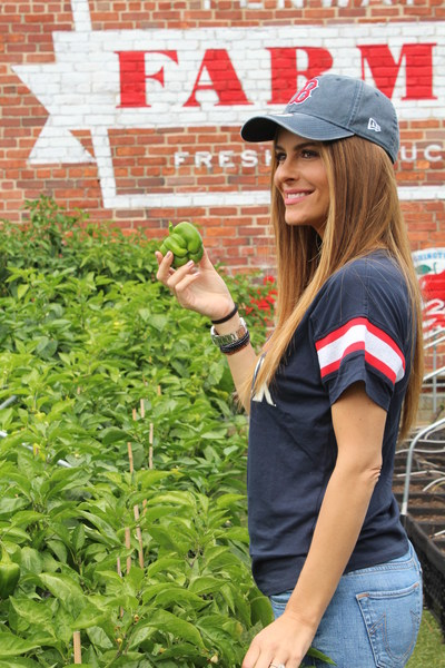 """Red Sox fan, Emmy winning host and best-selling author, Maria Menounos, tours Fenway Farms, where many of the organic ingredients for her new stand at Fenway Park, """"Maria's Greek Kitchen"""", are grown."""