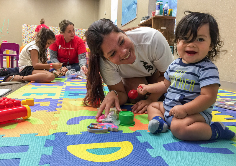 Mario*, 9-months-old, plays with his mother Emily in Save the Children's child-friendly space at Kazen Middle School in San Antonio, Texas, on August 28, 2017, where hundreds of displaced families are seeking refuge in the wake of Hurricane Harvey. Save the Children's emergency response team is in Texas working to meet children and families' immediate needs as Hurricane Harvey blasts inland from the Texas coastline. *Name changed for protection. Photo Credit: Susan Warner for Save the Children