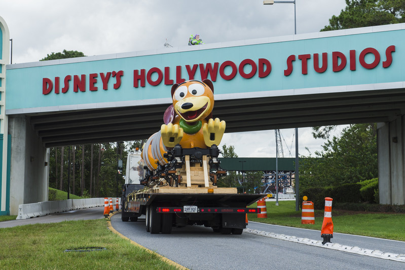 The first Slinky Dog Dash ride vehicle makes its way to Toy Story Land at Disney's Hollywood Studios in Lake Buena Vista, Fla. Slinky Dog Dash is a brand-new family coaster coming to the all-new Toy Story Land, opening summer 2018. Inspired by the playful dachshund spinoff of Slinky®, the classic American toy, Slinky® Dog Dash will send riders dipping, dodging and dashing around turns and drops that Andy has created to stretch Slinky® and his coils to the max. (Steven Diaz, photographer)