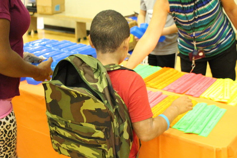 """Over 300 students """"shopped"""" the Inspirus backpack store last week to get new backpacks and school supplies for the new school year."""
