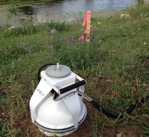 A Carbon dioxide flux chamber collecting natural source zone depletion data at a remediation site. NSZD technology can optimize site remedies and reduce costs.