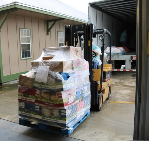 LyondellBasell's food donation is unloaded by volunteers at Catholic Charities of Southwest Louisiana. The company provided more than $15,000 worth of food to help feed Lake Charles residents impacted by Tropical Storm Harvey.
