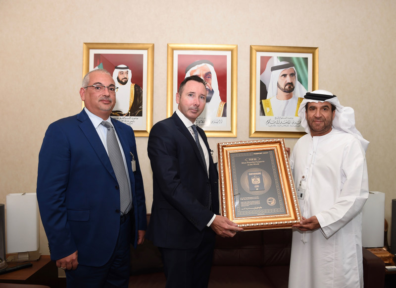 H.E. Ahmed Saeed Elham Al Dhaheri, Assistant Under-Secretary for Consular Affairs at the ministry of Foreign affairs and international cooperation of the UAE accepts the Passport Index certificate from Mr. Angel Kalinov and Mr. John Hanafin. (CNW Group/Arton Capital)