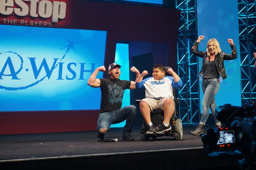 Solomon celebrates his wish reveal with WWE Announcer Renee Young and WWE Superstar Dean Ambrose at GameStop Conference and Expo in Las Vegas