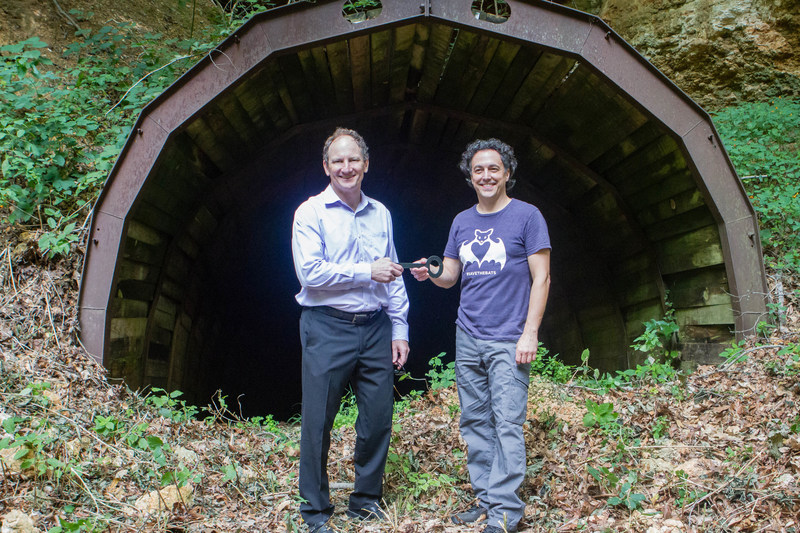 Campbell Jones, Unimin President & CEO, transfers the rights to the Magazine Mine, to Rob Mies, Executive Director for the Organization for Bat Conservation.
