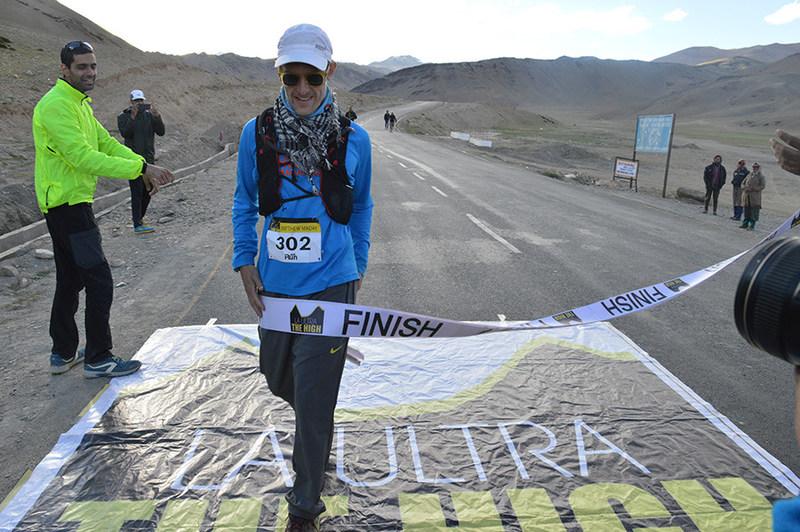Matthew Maday crossing the finish line
