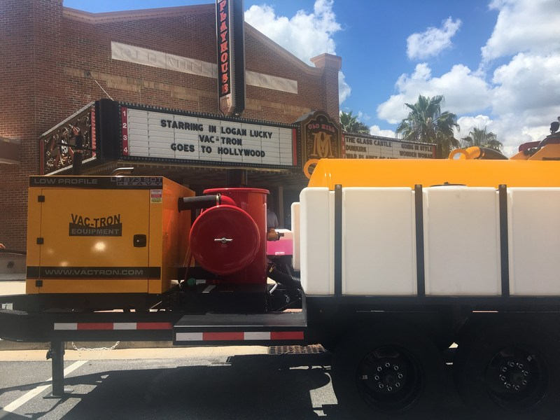 Vac-Tron's 6,000th vacuum excavation unit and the star of Logan Lucky in front of the Old Mill Playhouse in the Villages, FL.